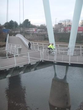 Riding across the bridge